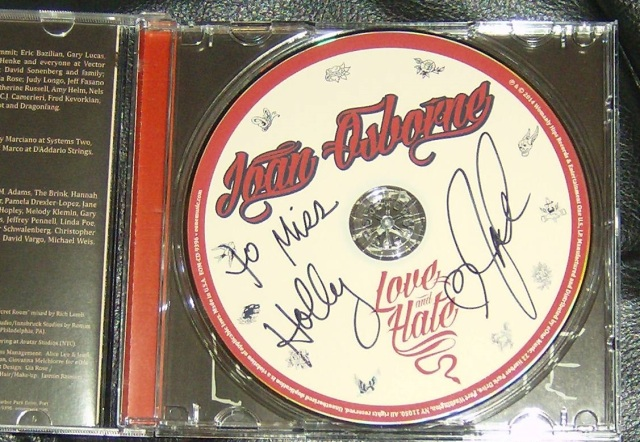 Autographed Love and Hate CD. Photo by Holly Tierney-Bedord. All rights reserved.